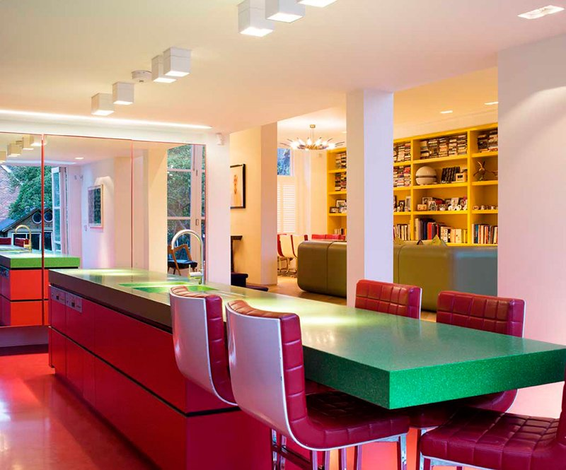 Tagged: Sofa, Chair, Storage, Light Hardwood Floor, Shelves, Table, and Kitchen.  Photo 5 of 13 in Bright Bauhaus Colors Fill This Brick Edwardian House in London