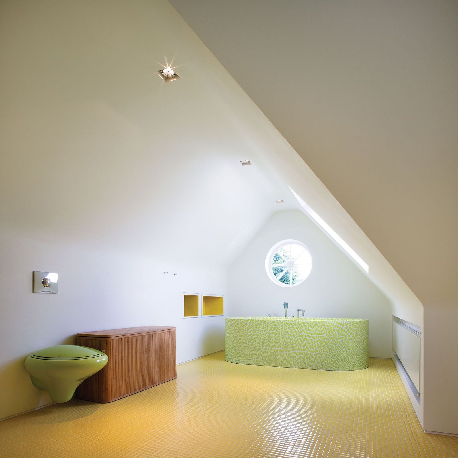 Tagged: Storage, Shelves, Table, Chair, One Piece Toilet, Bath Room, Recessed Lighting, Ceramic Tile Floor, Soaking Tub, and Freestanding Tub.  Photo 9 of 13 in Bright Bauhaus Colors Fill This Brick Edwardian House in London