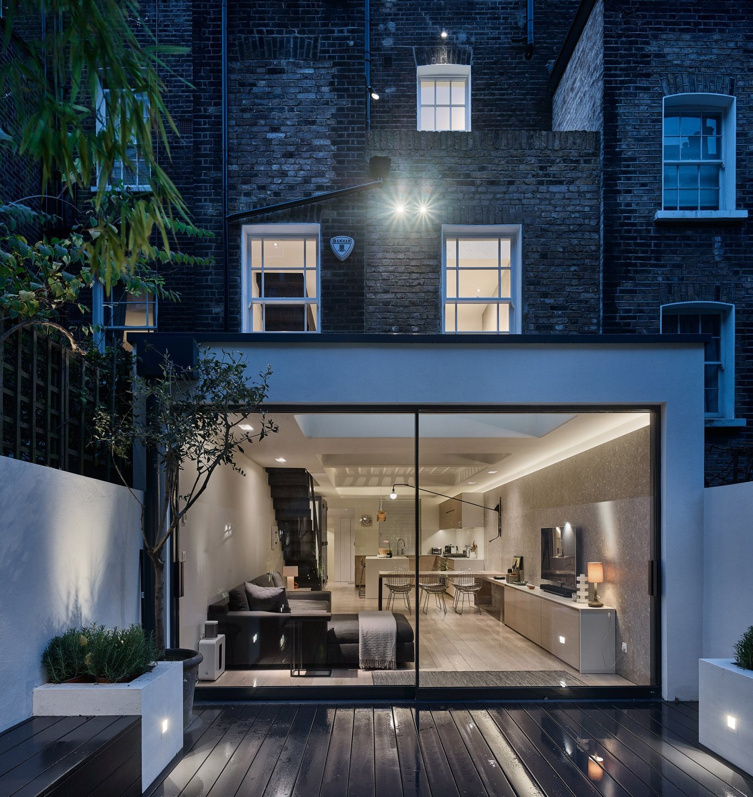 Tagged: Outdoor, Small Patio, Porch, Deck, and Wood Patio, Porch, Deck.  Photo 6 of 12 in Transparent Perforated Circles Bring Light and Movement to This London Terrace House