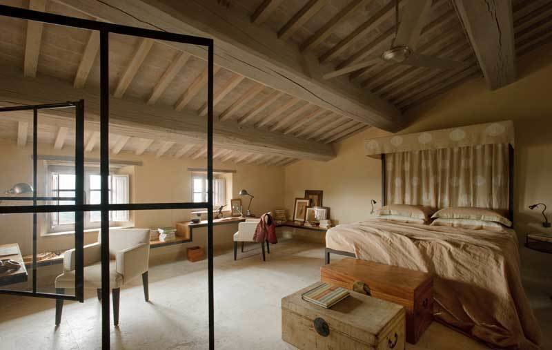 Tagged: Bedroom, Storage, Chair, Bed, Table Lighting, and Concrete Floor.  Photo 6 of 10 in Rustic Meets Modern In This Tuscan Village Boutique Hotel
