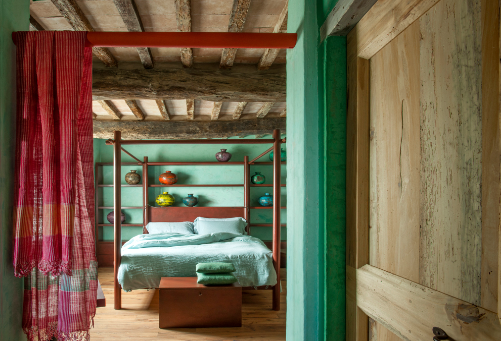 Tagged: Bedroom, Bed, Bench, and Medium Hardwood Floor.  Photo 2 of 10 in Rustic Meets Modern In This Tuscan Village Boutique Hotel