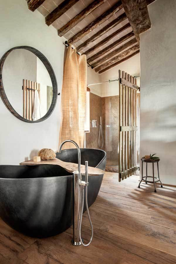 Tagged: Bath Room, Medium Hardwood Floor, Freestanding Tub, Soaking Tub, and Corner Shower.  Photo 9 of 10 in Rustic Meets Modern In This Tuscan Village Boutique Hotel