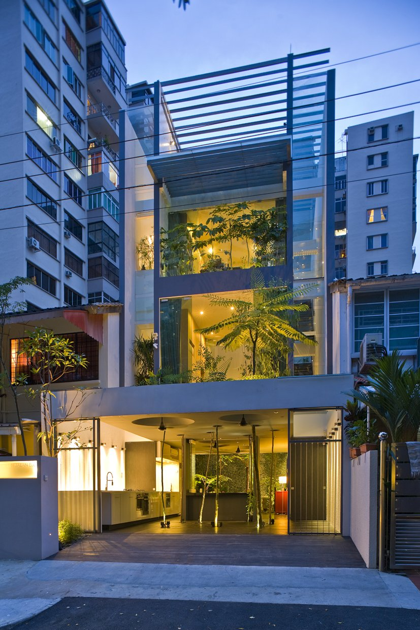 Tagged: Sofa, Ceiling Lighting, Dark Hardwood Floor, and Outdoor.  Photo 2 of 13 in This Modern Home in Singapore Is a Living Urban Jungle