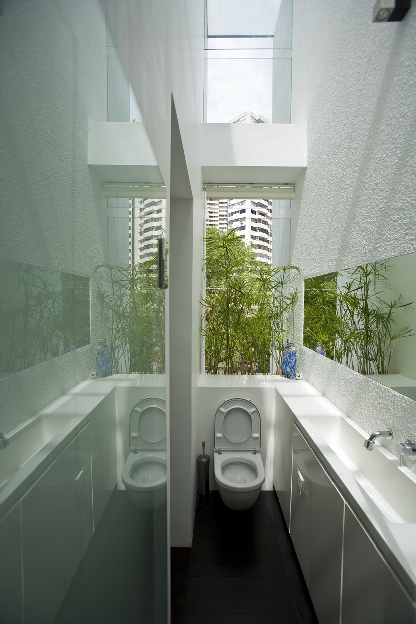 Tagged: Table, Wood Patio, Porch, Deck, Gardens, Rooftop, One Piece Toilet, Undermount Sink, Engineered Quartz Counter, Dark Hardwood Floor, Windows, and Skylight Window Type.  Photo 13 of 13 in This Modern Home in Singapore Is a Living Urban Jungle