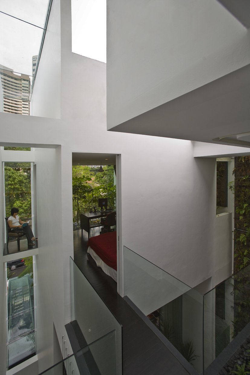 Tagged: Dark Hardwood Floor, Metal Tread, Sofa, Wood Patio, Porch, Deck, Ceiling Lighting, Table, Rooftop, Gardens, and Hallway.  Photo 9 of 13 in This Modern Home in Singapore Is a Living Urban Jungle