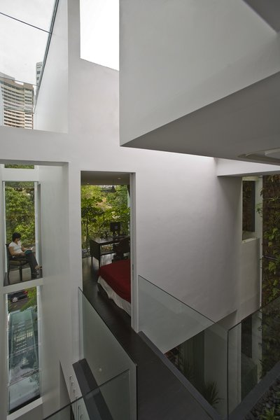 Tagged: Wood Patio, Porch, Deck and Table.  Photo 9 of 13 in This Modern Home in Singapore Is a Living Urban Jungle