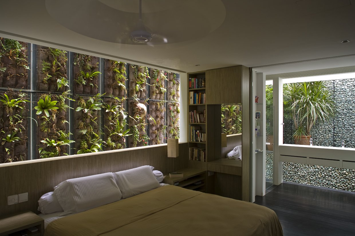 Tagged: Sofa, Rooftop, Wood Patio, Porch, Deck, Gardens, Table, Ceiling Lighting, and Bedroom.  Photo 10 of 13 in This Modern Home in Singapore Is a Living Urban Jungle
