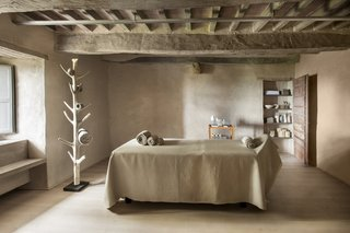 A Tree-Filled Spa That Brings Warm Modernism to a 900-Year-Old Tuscan Village - Photo 1 of 8 -