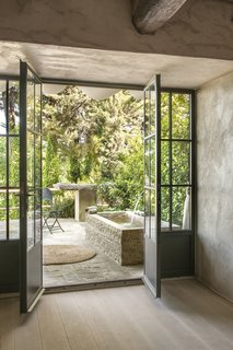 A Tree-Filled Spa That Brings Warm Modernism to a 900-Year-Old Tuscan Village - Photo 3 of 8 -