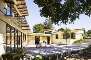10 Homes With Large, Well-Ventilated Courtyards - Photo 1 of 9 - On a north-sloping site in Palo Alto, California, three distinct volumes are jointed in this residence to create an internally-focused private courtyard that sits adjacent to a mature stand of live oak trees.