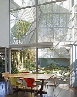 10 Homes With Large, Well-Ventilated Courtyards - Photo 3 of 9 - To create privacy, Kevin Daly Architects created a two-story glazed facade facing a landscaped courtyard, and shaded it with a perforated, folding metal skin that's supported by an aluminum exoskeleton.