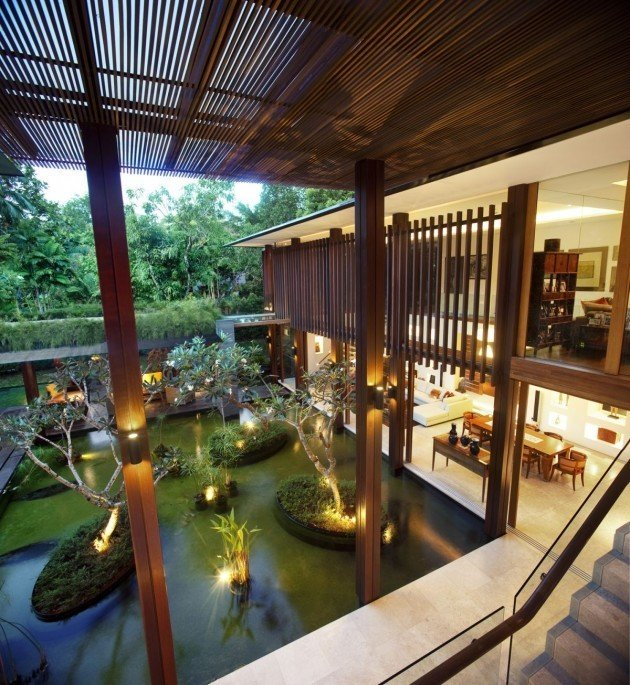 This house in Singapore was designed to be used without air-conditioning so increased ventilation, coolness and protection from the strong heat and torrential rains were factors that the architect kept in mind when designing the space.  Photo 6 of 10 in 10 Homes With Large, Well-Ventilated Courtyards