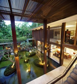 10 Homes With Large, Well-Ventilated Courtyards - Photo 5 of 9 - This house in Singapore was designed to be used without air-conditioning. When designing the space, the architect considered a number of factors, including increased ventilation, coolness, and protection from the strong heat and torrential rains.