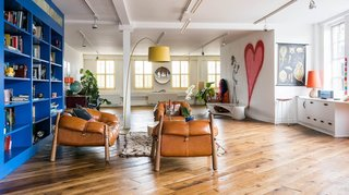 """10 Modern Homes in London - Photo 9 of 10 - Indoor graffiti, wacky artwork, colors that pop, a red """"papa bear"""" lounge chair, and a 3,000-square-foot living area are just some of the reasons why this apartment is a one of the most sought-after holiday rentals in the artsy neighborhood of Shoreditch."""