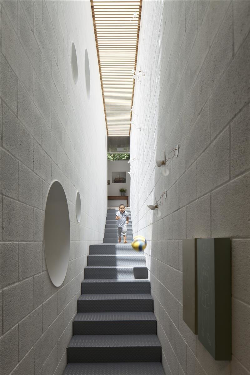 Tagged: Staircase and Metal Tread.  Best Photos from An Architect's Bright and Airy Family Home Thrives Within a Brutalist Concrete Structure