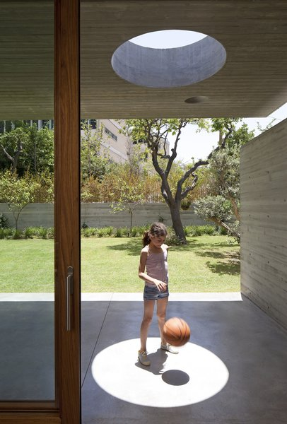 Modern home with outdoor, grass, trees, back yard, and concrete patio, porch, deck. Photo 5 of House of an Architect