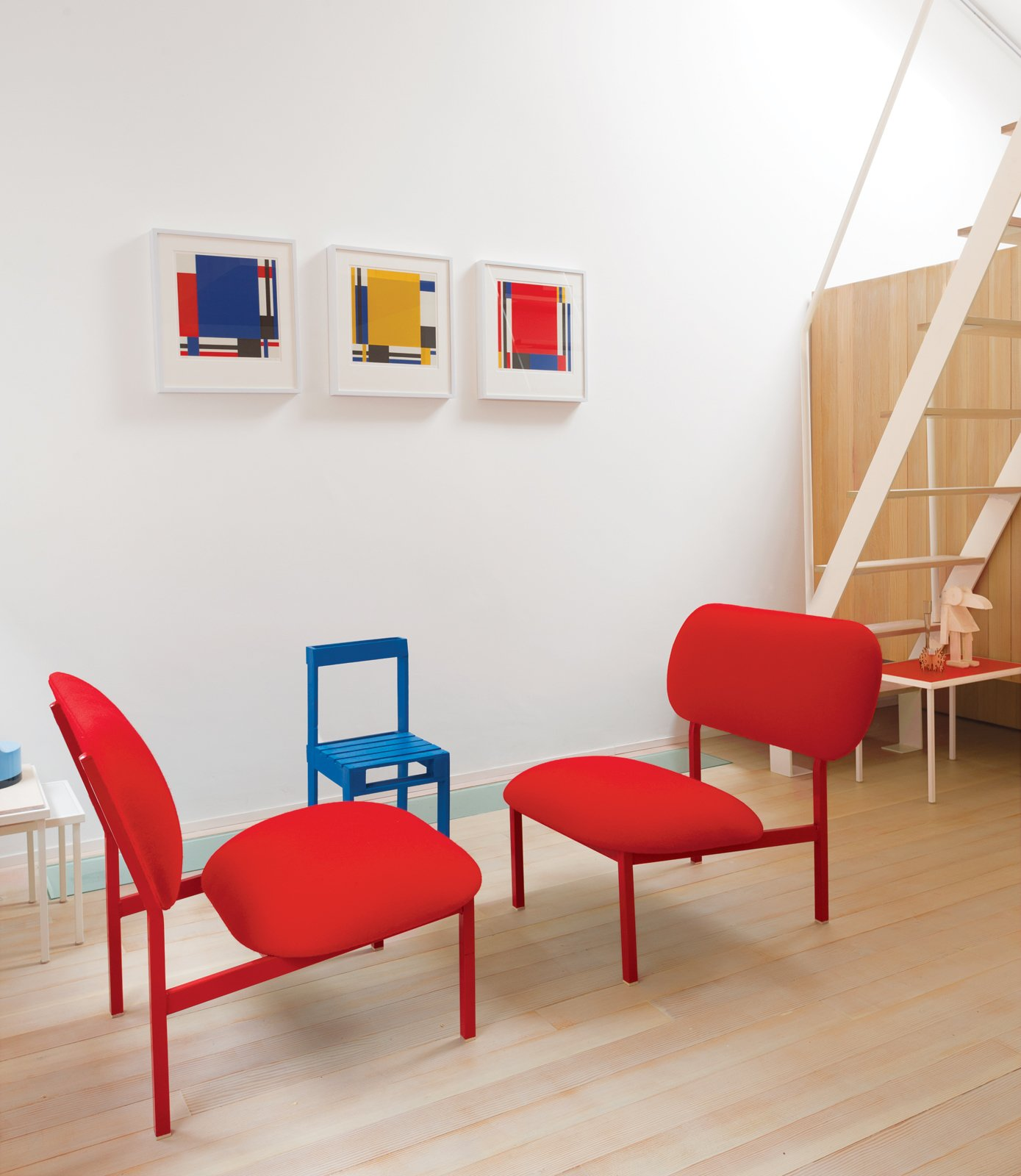 Just outside the Bethnal Green home of industrial designer Nina Tolstrup and her husband, Jack Mama, is this wonderfully vibrant guesthouse they designed with  red chairs made from castoffs as part of Tolstrup's Re-Imagine series, and a small blue Pallet chair from Studiomama.