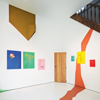 9 Small Spaces With  Color - Photo 2 of 9 - Works by Raw Color adorn the walls of the upstairs gallery room of Belgium architect and artist Veerle Wenes.