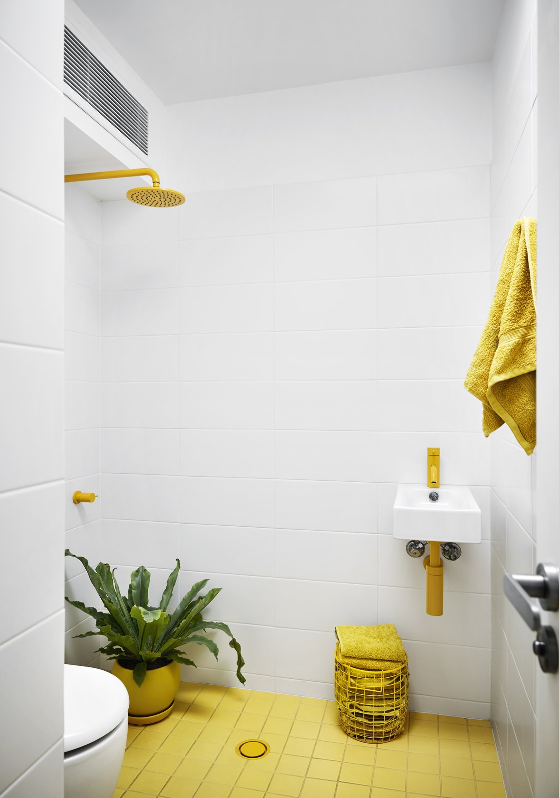 Tagged: Bath Room, Ceramic Tile Floor, Wall Mount Sink, Open Shower, and Ceramic Tile Wall.  Photo 8 of 12 in An Architect Turns His Victorian Home Into a Sun-Drenched Live/Work Space