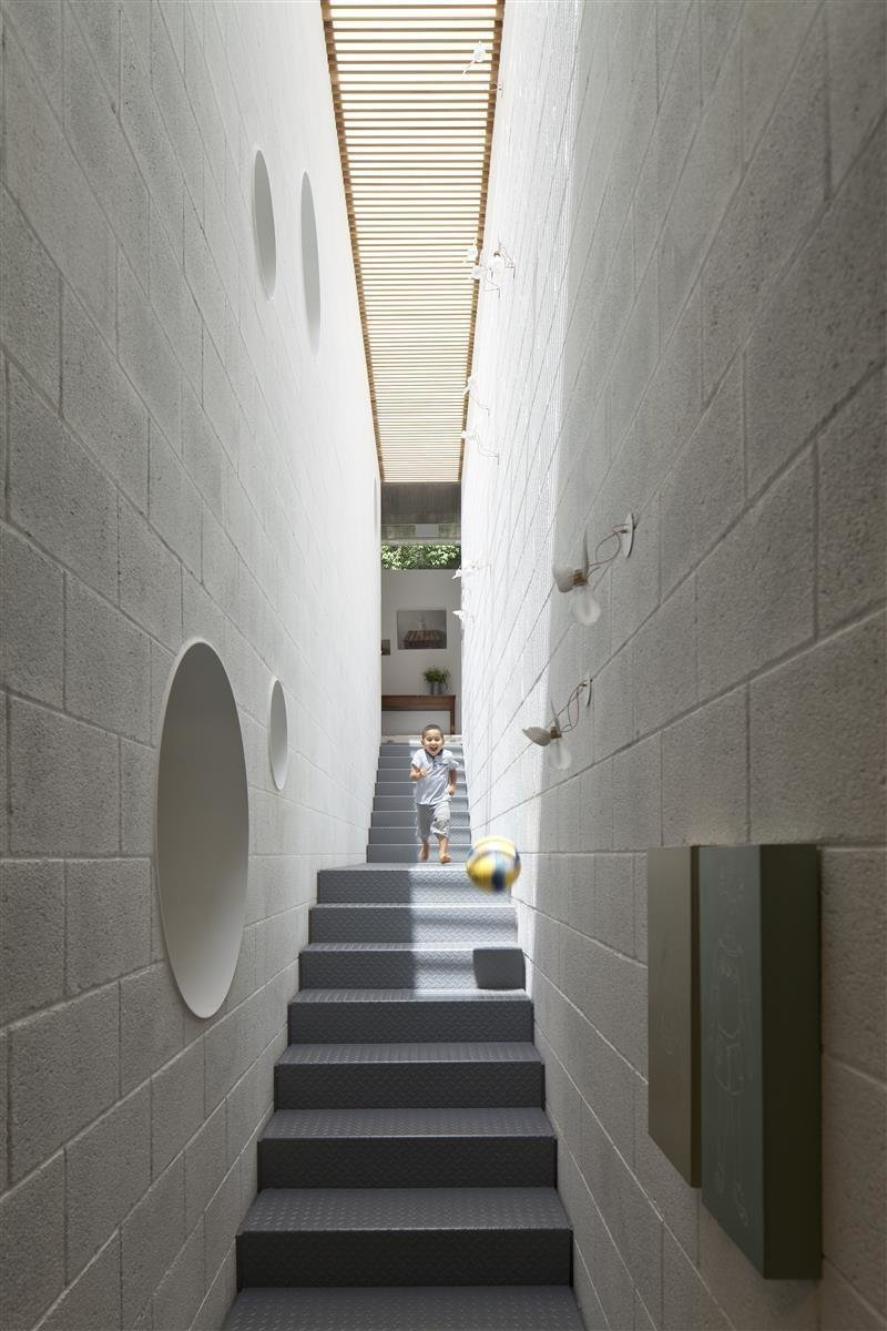 In the home of Israeli architect Pitsou Kedem is an elongated skylight that runs along the entire length of a stairwell, flooding the interiors with sunshine. Tagged: Windows, Skylight Window Type, and Wood.  Photo 2 of 10 in 10 Light-Filled Homes With Interesting Skylights