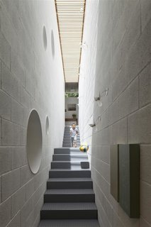 10 Light-Filled Homes With Interesting Skylights - Photo 2 of 10 - In the home of Israeli architect Pitsou Kedem is an elongated skylight that runs along the entire length of a stairwell, flooding the interiors with sunshine.
