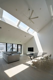 10 Light-Filled Homes With Interesting Skylights - Photo 8 of 10 - Australian practice PandA Studio Architecture designed House Nakamaruku in Kanagawa, Japan, with skylights on the upper level that bring in plenty of natural light without compromising privacy.