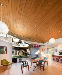 10 Light-Filled Homes With Interesting Skylights - Photo 10 of 10 - A large glassless opening on the sloping curved shed roof of this Californian home opens the courtyard to the sky and the elements, while giving the surrounding living areas an almost outdoor, park-like feel.