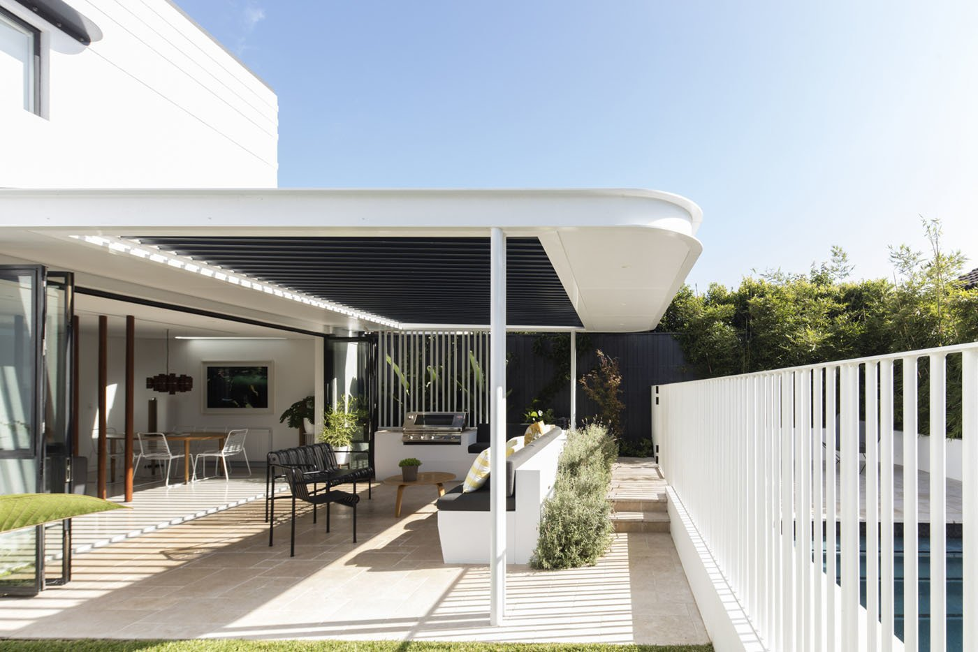 Tagged: Outdoor, Back Yard, Trees, and Metal Fences, Wall.  Photo 7 of 12 in A Heritage Art Deco House in Australia Gets a Modern Update