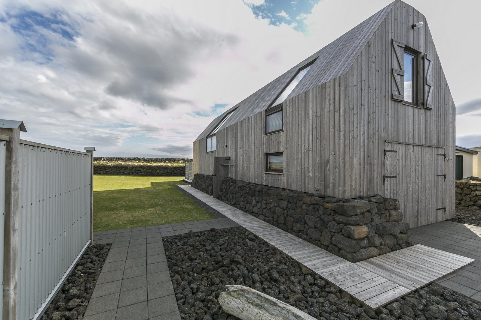 Photo 1 of 12 in Get in Touch With Iceland's Rugged Landscape While Staying at This Modern Coastal Barn