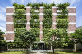 Designed by sustainable Vietnamese practice Vo Trong Nghia, the Atlas Hotel in Hội An, Vietnam, has more that 100 cantilevered concrete planters. The trailing plants that overhang from the balconies create the effect of a green facade that shades the guest rooms from the strong sunshine.