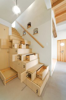 "10 Homes With Clever Storage Solutions - Photo 5 of 10 - Using a centuries-old Japanese carpentry concept of ""kaidan dansu"" (mobile storage cabinetry), this home in Koriyama, Japan, by architect Kotaro Anzai has a modern staircase cabinet made of linden plywood that connects the ground floor living room to the upper level of the house."