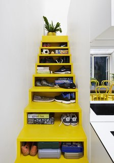 10 Homes With Clever Storage Solutions - Photo 9 of 10 - Architect Andrew Maynard's Melbourne home, which also doubles up as the office of his practice Austin Maynard Architects, includes a bright yellow staircase with opening slots in the front that serve as storage shelves.