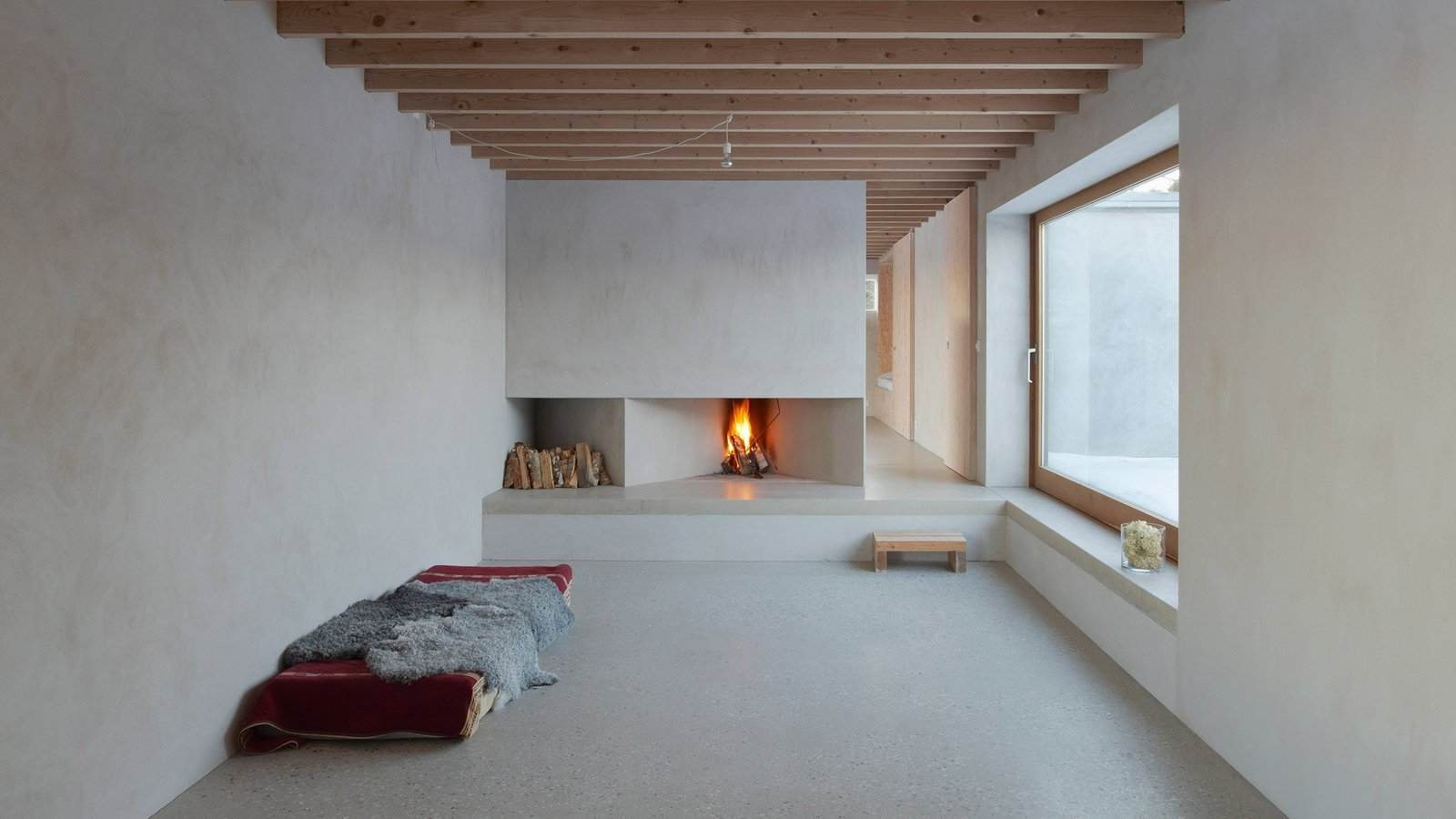 Tagged: Living Room, Standard Layout Fireplace, Concrete Floor, and Wood Burning Fireplace.  Photo 5 of 7 in 7 Tips For Creating Your Own Home Meditation Zone