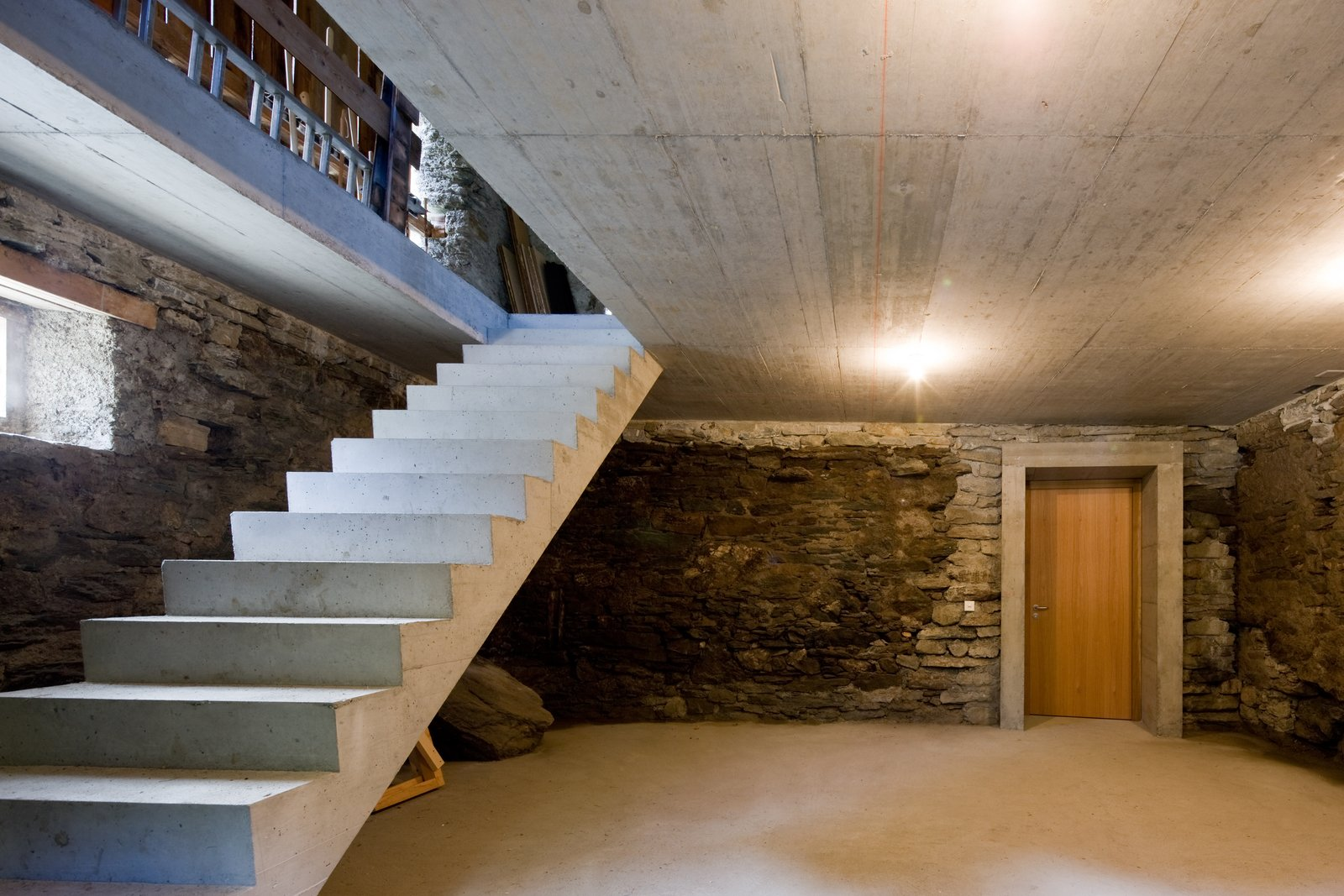 Tagged: Staircase and Concrete Tread.  Photo 8 of 13 in Stay in a Swiss Vacation Home That's Literally Inside a Mountain