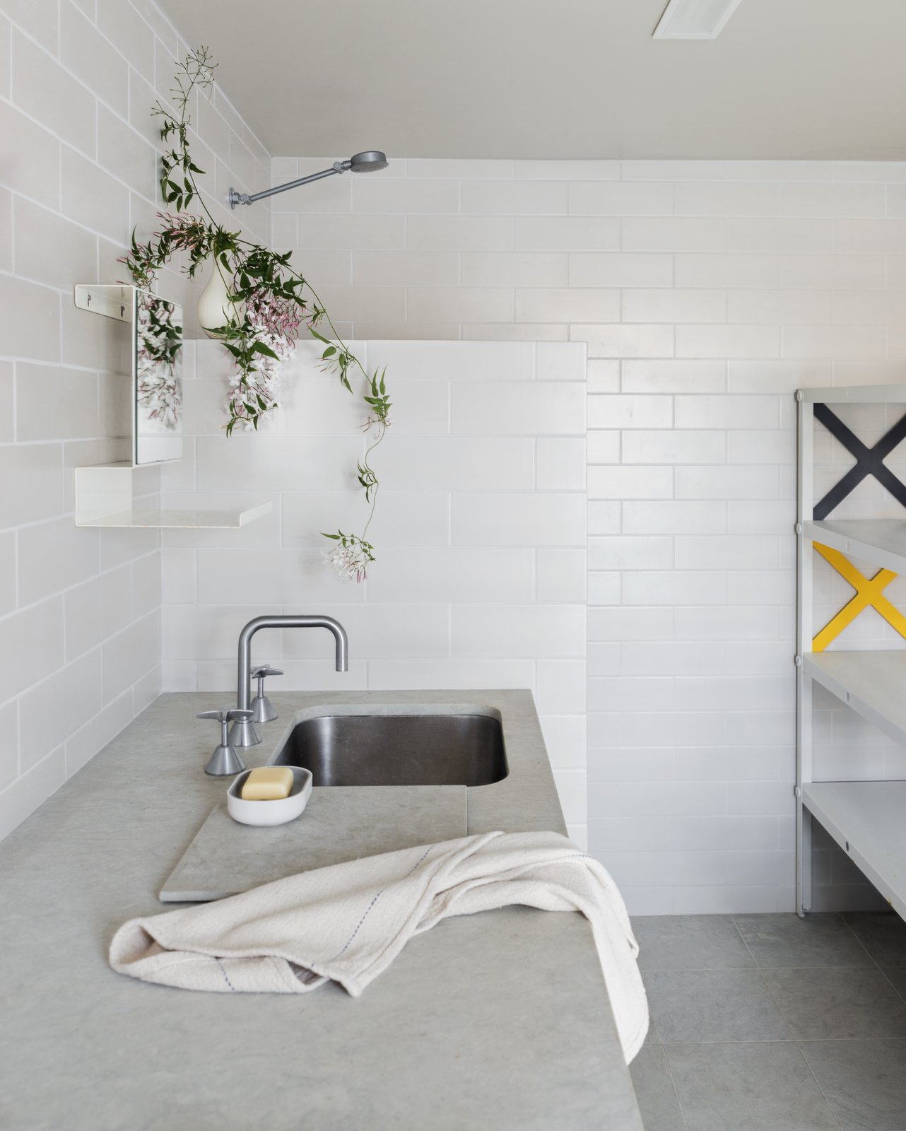 Tagged: Concrete Counter, Bath Room, Concrete Floor, Open Shower, Undermount Sink, Subway Tile Wall, and Ceramic Tile Wall.  Photo 10 of 13 in Stay in a Riverside Vacation Home That Embraces the Australian Bush