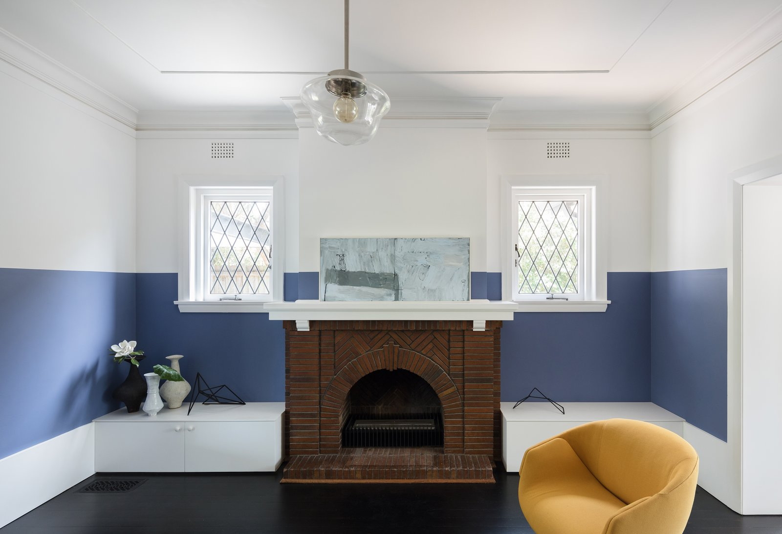 Tagged: Living Room, Pendant Lighting, Chair, and Standard Layout Fireplace. This 1930s Bungalow in Sydney Was Preserved in the Front and Updated in the Back - Photo 5 of 13