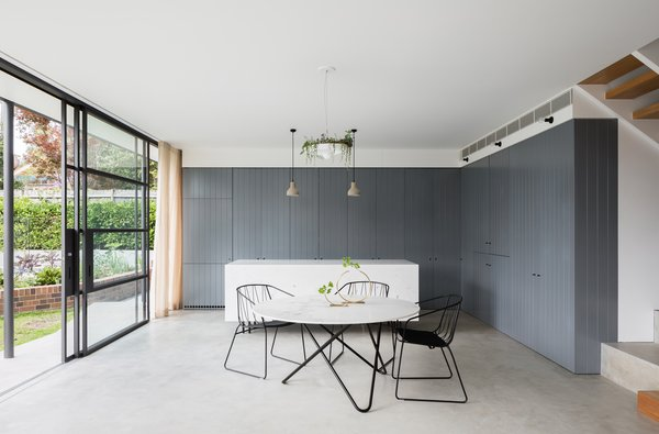 Modern home with dining room, chair, table, pendant lighting, and concrete floor. Photo 6 of House Au Yeung