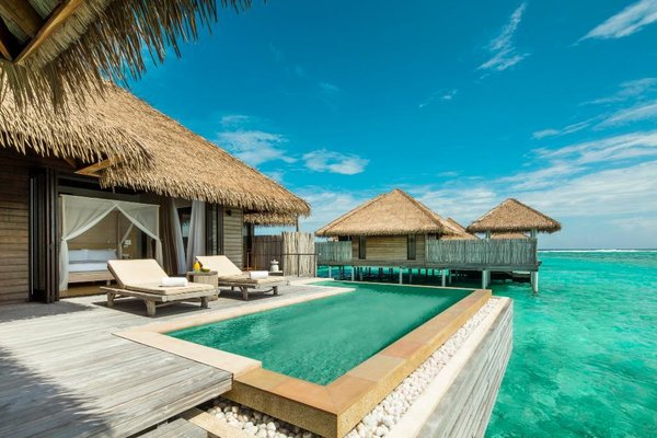 The 1,152 square feet overwater villas at this resort have wide doors that open to a terrace with a plunge pool facing the turquoise lagoon and their own private jetties.