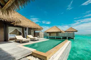 9 Modern Maldivian Resorts With Spectacular Overwater Villas - Photo 3 of 9 - The 1,152-square-foot overwater villas at this resort have wide doors that open to a terrace with a plunge pool facing the turquoise lagoon, as well as their own private jetties.
