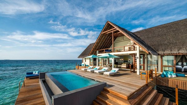 Sited within 44 acres of Unesco World Biosphere Reserve in the Baa Atoll, the thatched water villas at this resort are designed with floor to ceiling windows for panoramic ocean views.