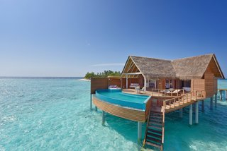 9 Modern Maldivian Resorts With Spectacular Overwater Villas - Photo 9 of 9 - The thatched-roof Water Pool villas at Milaidhoo Island are equipped with Maldivian-style swing chairs, ocean-facing king sized beds, and large private pools.