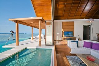 9 Modern Maldivian Resorts With Spectacular Overwater Villas - Photo 1 of 9 - Sleek and commodious, some of the villas in this resort have indoor and outdoor showers as well a jacuzzi that's great for a leisurely soak under the stars at night.