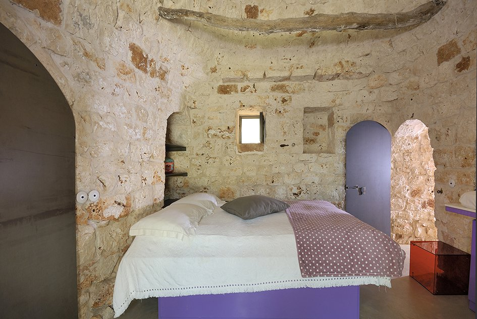 Tagged: Bedroom, Bed, and Concrete Floor.  Photo 8 of 11 in Ever Wanted to Stay in an Ancient Trullo in Puglia, Italy?