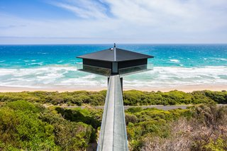 10 Cliffside Destinations That Will Make You Feel on Top of the World - Photo 3 of 10 - Rumored to be one of the most photographed homes on the Great Ocean Road, this house is suspended 131 feet above Fairhaven Beach. Designed by F2 Architecture, the house balances atop a concrete platform supported by a 42-foot-high plylon and is accessible via a narrow bridge.