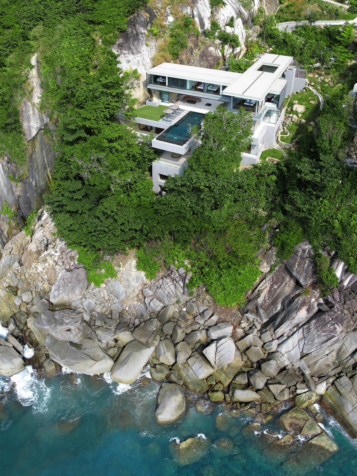 Designed by Asia-based practice Original Vision, this villa located on Cape Sol in Kamala Kathu, Phuket, is a stunning and spacious contemporary residence that inspires total relaxation. Available for rent through Ministry of Villas.  Photo 5 of 10 in 10 Cliffside Destinations That Will Make You Feel on Top of the World