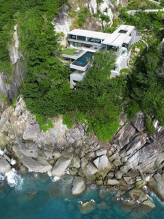 10 Cliffside Destinations That Will Make You Feel on Top of the World - Photo 5 of 10 - Designed by Asia-based practice Original Vision, this villa located on Cape Sol in Kamala Kathu, Phuket, is a stunning and spacious contemporary residence that inspires total relaxation.