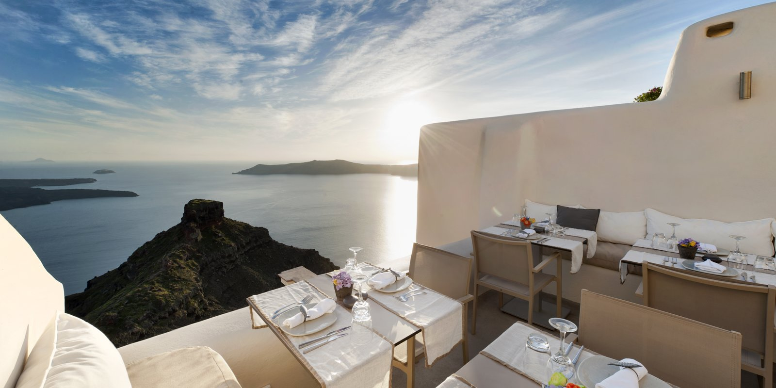 At this modern Cycladic boutique hotel, you can enjoy breathtaking views of Santorini's majestic caldera from the pool, your bedroom or the resort's fine dining restaurant.