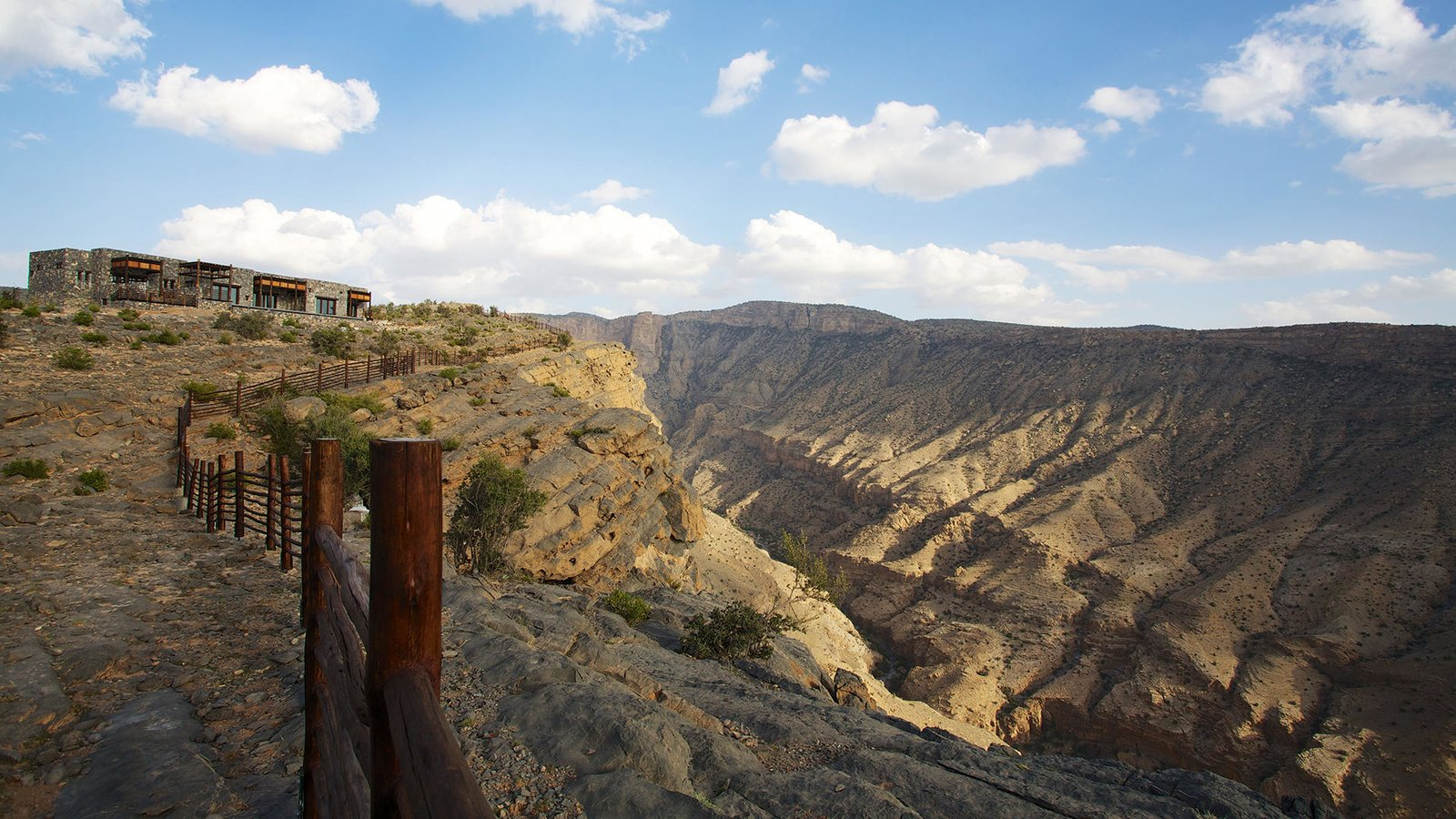 Perched high on a ridgeline, almost 2,000 meters above sea level in the Al Hahar Mountains, this resort, which was opened in 2016, is a rustic yet contemporary retreat that puts you in the midst of Oman's stunning natural landscape.  Photo 9 of 10 in 10 Cliffside Destinations That Will Make You Feel on Top of the World