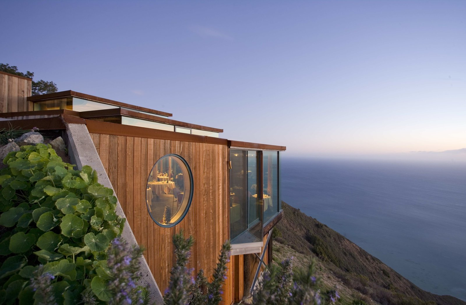 The Cliff House in Post Ranch Inn is a free-standing structure with a large outdoor deck hanging over the cliffs.  Photo 2 of 10 in 10 Cliffside Destinations That Will Make You Feel on Top of the World