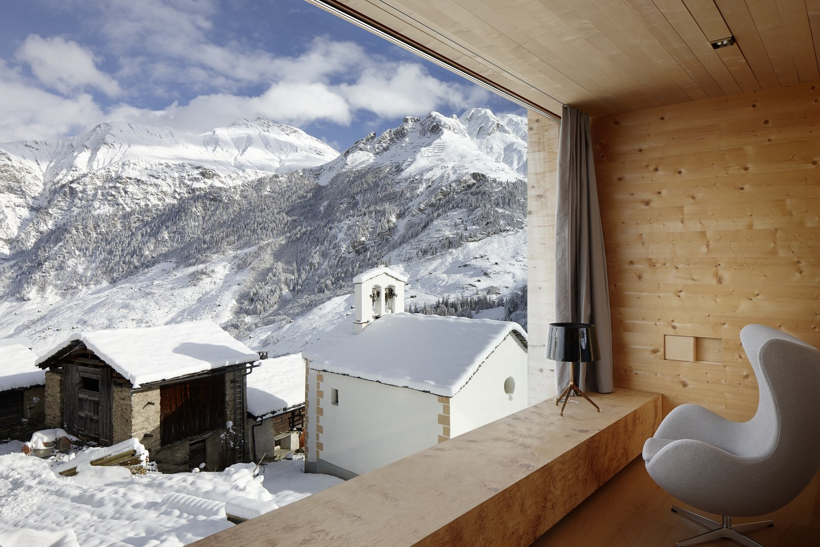 Located in the Graubünden region of the Swiss mountains, this vacation property, designed by Swiss architect Peter Zumthor is a modern reinterpretation of the traditional timber houses found in the area of Leis.  Photo 4 of 8 in 7 Alpine Holiday Chalets in Switzerland